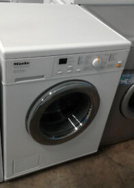 n214 white miele 5kg 1300spin washing machine comes with warranty can be delivered or collected