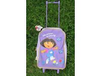 DORA THE EXPLORER PURPLE PULL ALONG TROLLEY BRAND NEW WITH TAGS