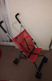 RED SCALLYWAGS STROLLER - £6