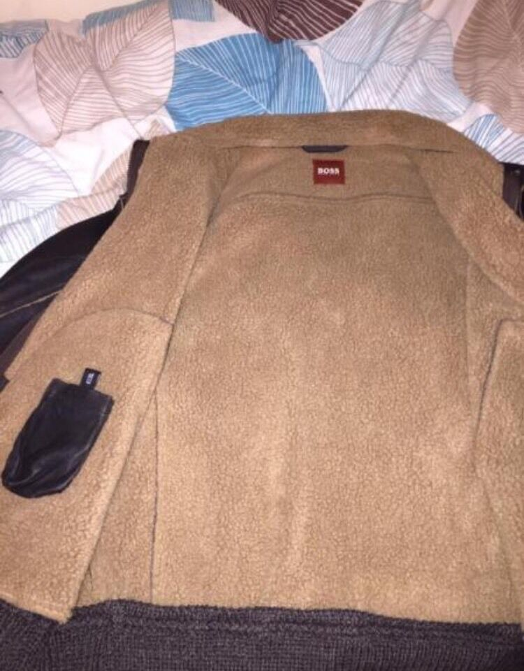 BROWN HUGO BOSS LEATHER JACKET FAUXin Ilford, LondonGumtree - Hugo boss 100% authentic brown leather jacket. Size large. Needs to go ASAP.Brilliant detailing.Selling due to having too many jackets. Bought it for £350 from Hugo boss website in 2012Thick and warm jacketCONTACT ASAP 07479070400Negotiations...