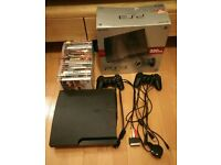 Barely used 320GB PS3 with box, 2 controllers and 19 games