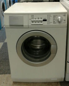 o438 white aeg 8kg 1400spin washing machine comes with warranty can be delivered or collected