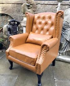 Beautiful QueenAnne Wingback chair finished in tan brown leather with matching scatter cushion