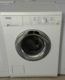 P698 white miele 5kg 1200 spin washing machine comes with warranty can be delivered or collected