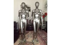 X2 silver shop mannequins on glass stands