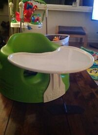 Lime green bumbo seat with tray