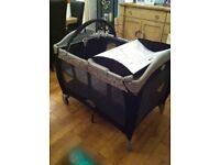 Graco Travel Cot With Bassinett, changing mat, vibration and tunes.