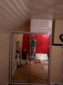 White wardrobe with mirror sliding doors