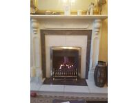 White marble fireplace with marble and granite hearth and inset