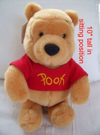 """10"""" Winnie The Pooh soft toy (sitting pose) from Disneyland, Paris + original tag. £6 ovno. Can post"""