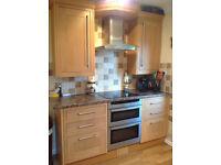 Kitchen cupboards with solid oak doors
