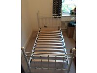 Single bed with white metal antique-look frame and Silentnight mattress