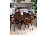Fabulous dark 42 inch round farmhouse oak table and 4 chunkye farmhouse chairs