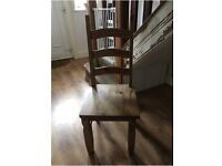 For Sale. 5 great condition solid pine chairs. High backed and great left or as a project