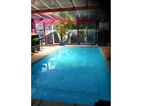 Double room in large home with indoor pool..
