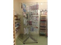 Triangular grid wall display on casters. 3 off 6ft x 2ft panels and base on wheels.