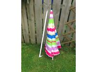 Garden table umbrella good condition hardly used good at the price .