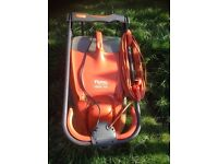 electric lawn mower flymo 330 used once and a petrol strimmer
