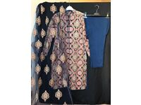 Navy blue heavy net dress with net dupatta and trousers.