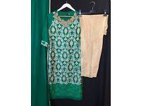 Dark green Agha noor kurta, trousers and dupatta.