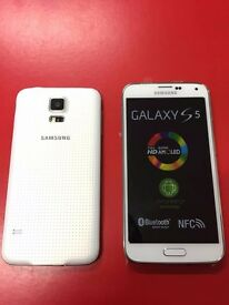 SAMSUNG GALAXY S5 SIMFREE IN WHITE GRADE A LIKE NEW COMES WITH CHARGER AND THREE MONTHS WARRANTY