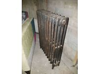 8 Ideal Standard cast iron column radiators (one damaged)
