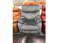 High retail faux suede reclining armchair