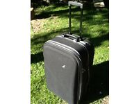 Large black nylon suitcase by metropolis