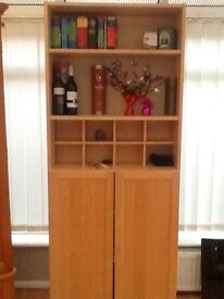 Tall display unit with doors in light oak