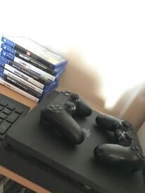 Playstation 4 Slim, Excellent Condition, comes with 2 controllers and 8 Games