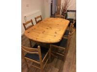 Extendable dining table and chairs