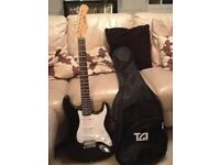 Stagg Stratocaster style Electric Guitar, Stagg Amplifier and Guitar Bag