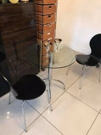 Glass Table with 2 Black chairs