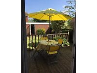 Garden table with 4 chairs and umbrella