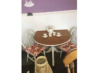 Half moon table with two farmhouse chairs plus 2 Laura Ashley Cushions.