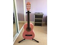 Child's pink guitar, stand and carry case