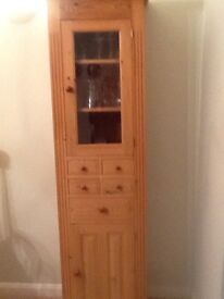 Pine tall Cupboard with glass fronted door on top cupboard