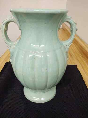 Large McCoy light blue double handled baluster vase.