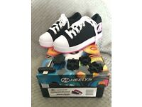 2 pairs of Heelys, red and white size 13, pink and white size 1