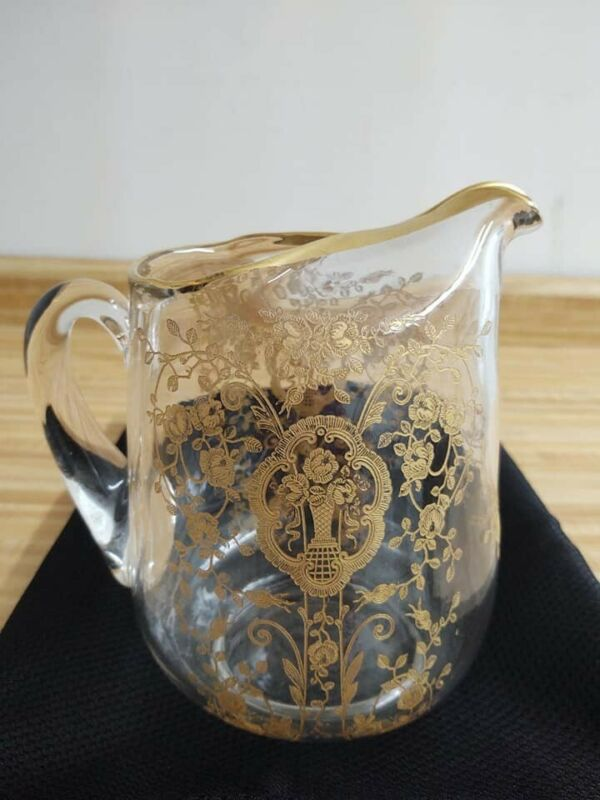Gold gilded depression glass ? pitcher.