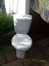 Clean white modern toilet, complete with seat
