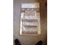 2 sets of Lined Eyelet Curtains & 4 matching cushion covers