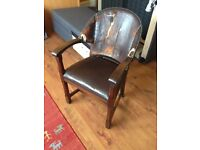 Handsome solid wood and leather chair.