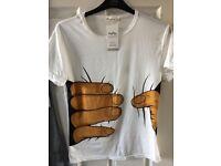 Women's hands on t-shirt