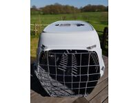 Small grey pet / dog / cat carrier / travel box crate with metal door