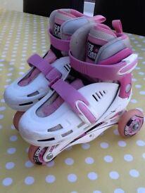 White/pink adjustable roller skates, size 8-11 junior