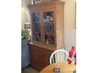 Sold pine dresser with glass top and two shelves waxed finish very good condition H 196 W106 D42