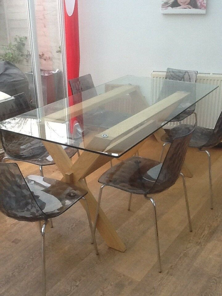 Glass table with Six Contempory Chairs