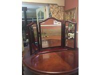 Triple beveled mahogany mirror