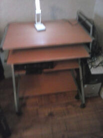 Computer Desk ~ Used good condition on wheels L~ 28 inches , W ~ 19 in. , H~ 2ft. 6in.